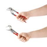 Комплект руки держа инструмент ключа водопроводчика, состав изолированный над белой предпосылкой Стоковые Изображения RF