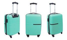 Комплект света - голубого чемодана изолированного на белой предпосылке Стоковые Фотографии RF