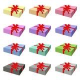Комплект симпатичной подарочной коробки с красной лентой Стоковая Фотография
