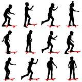 Комплект силуэта скейтбордистов Стоковые Изображения RF