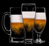 Комплект стекел пива на черной предпосылке Стоковые Изображения