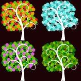 Комплект стилизованных деревьев в различных сезонах Стоковая Фотография