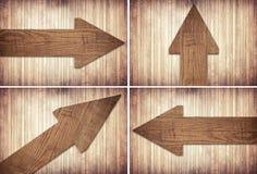 Комплект стрелки темного коричневого цвета деревянной на стене Стоковая Фотография RF
