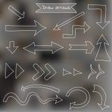 Комплект стрелок притяжки на запачканной предпосылке Стоковое Изображение
