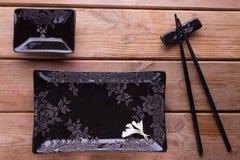 Комплект суш черного квадрата стоковое изображение