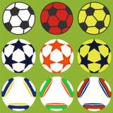 Комплект футбольных мячей иллюстрация штока