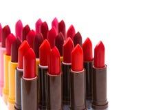 Комплект цвета губных помад красного на белой предпосылке Стоковое Изображение
