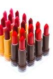 Комплект цвета губных помад красного на белой предпосылке Стоковое Изображение RF
