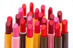 Комплект цвета губных помад красного на белой предпосылке Стоковое Фото