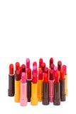 Комплект цвета губных помад красного на белой предпосылке Стоковая Фотография