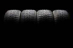 Комплект 4 черных автошин автомобиля выровнянных вверх по горизонтально Стоковое Изображение