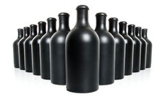 Комплект черных бутылок глины на белой предпосылке Стоковые Изображения