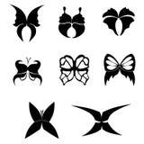 Комплект черных силуэтов бабочек на белой предпосылке Стоковые Фото