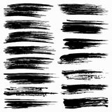 Комплект черных ходов щетки на белой предпосылке Стоковые Изображения