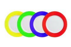 Комплект Multi покрашенных плит на белизне Стоковое Изображение