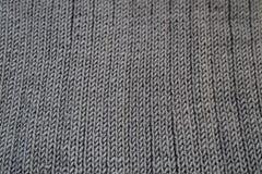 Конец-вверх безшовным связанной серым цветом текстуры ткани Стоковая Фотография RF