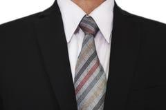 Конец-вверх бизнесмена нося черный костюм с серой связью, белую рубашку Стоковые Изображения RF