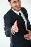 Конец-вверх бизнесмена предлагая рукопожатие Стоковая Фотография