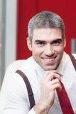 Конец-вверх бизнесмена усмехаясь на камере Стоковая Фотография RF