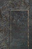 Конец-вверх выбитой огорченной винтажной обложки книги Стоковые Изображения RF