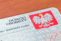 Конец-вверх для части польского удостоверения личности на деревянном столе стоковое фото rf