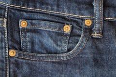 Конец-вверх джинсовой ткани голубых джинсов Стоковые Фото