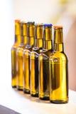 Конец-вверх загерметизированных пивных бутылок Стоковая Фотография