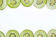 Конец-вверх зеленого куска плодоовощ кивиа на белой предпосылке Стоковая Фотография