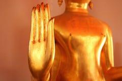 Конец-вверх золота руки Будды Стоковые Изображения