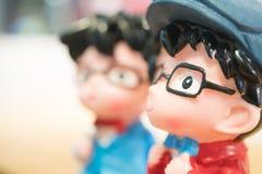 Конец вверх куклы ребенка куклы игрушки фарфора, милого и симпатичных Азии стоковые фотографии rf