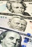 Конец-вверх на числах долларовых банкнот Стоковое Изображение RF