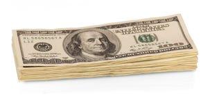 Конец-вверх долларовых банкнот стога 100 изолированный на белизне Стоковое Изображение