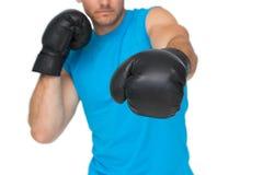 Конец-вверх решительно мужского боксера сфокусировал на тренировке Стоковое Фото