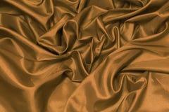 Конец вверх роскошной ткани золота или жидкостных створок o волны или волнистых Стоковое Фото