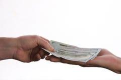 Конец-вверх руки персоны давая деньги банкнот доллара США Стоковое Фото