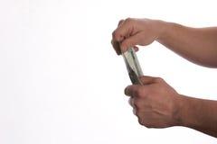 Конец-вверх руки персоны давая деньги банкнот доллара США Стоковое фото RF