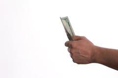 Конец-вверх руки персоны давая деньги банкнот доллара США Стоковые Изображения RF