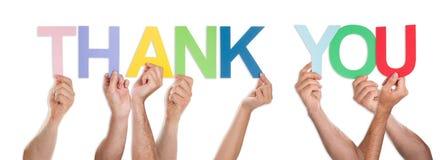 Конец-вверх рук держа слово спасибо Стоковое Изображение