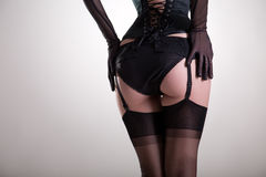 Конец-вверх снял сексуальных женских батокс в винтажном женское бельё Стоковая Фотография