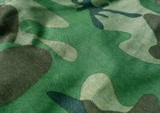 Конец-вверх ткани камуфлирования равномерный с влиянием нерезкости Стоковые Фото