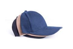 Конец вверх установил новую шляпу бейсбола изолированный на белизне Стоковое фото RF