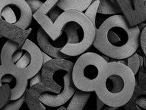 Конец-вверх черных деревянных цифров Стоковое Изображение