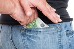 Конец-вверх человеческих рук кладя деньги Стоковые Фотографии RF