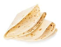 Конец-вверх tortillas пшеницы круглый изолированный на белой предпосылке Lavash стоковые фотографии rf