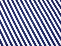 Конец голубых и белизны нашивок ткани вверх по предпосылке текстуры Стоковая Фотография