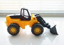 Конец затяжелителя колеса игрушки вверх Стоковая Фотография