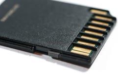 Конец карточки SD вверх по изолированной съемке макроса Стоковые Фотографии RF