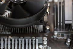 Конец компьютерной аппаратуры Bastract темный вверх по предпосылке Стоковые Изображения RF