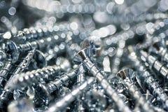 Конец макроса винтов серебра вверх свирль картины конструкции предпосылки цветастая Стоковые Изображения RF