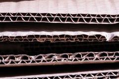 Конец отрезка коричневой бумаги картона старый вверх по структуре текстуры стоковое изображение